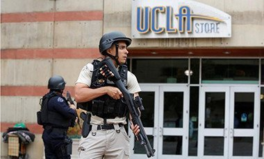 A Los Angeles Metro Police officer stands watch on the University of California, Los Angeles (UCLA) campus after it was placed on lockdown following reports of a shooter in Los Angeles, California June 1, 2016. Pix: Reuters