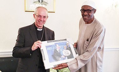 President Muhammadu Buhari (right) presenting a gift to the Archbishop of Canterbury, Justin Welby.