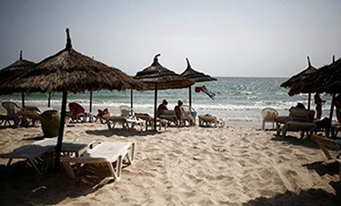 Tourists relax on the beach of El Ksar hotel in Sousse, Tunisia June 24, 2016. Photo: Reuters