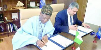 Lai Mohammed and the UNWTO's Secretary-General signing agreement for African Tourism meeting