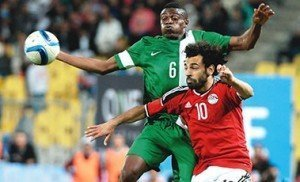 Egypt's Mohamed Salah (right) and Nigeria's Stanley Amuzie during their African Cup of Nations qualification match played at the Borg el-Arab Stadium in Alexandria...on Tuesday. Photo: AFP