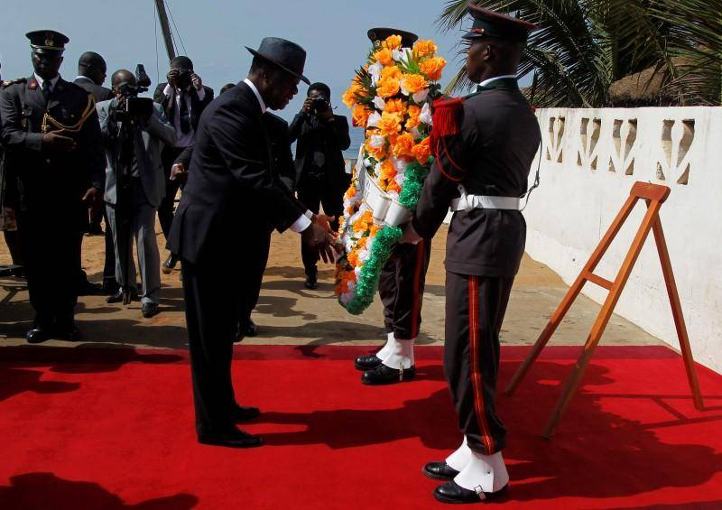 Ivory Coast's President Alassane Ouattara prepares to lay a wreath for those killed in Sunday's attack by Al Qaeda in the Islamic Maghreb, on a beach in Grand Bassam.