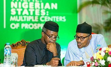 President Muhammady Buhari stressing a point to the Vice President Yemi Osinbajo during the economic retreat.
