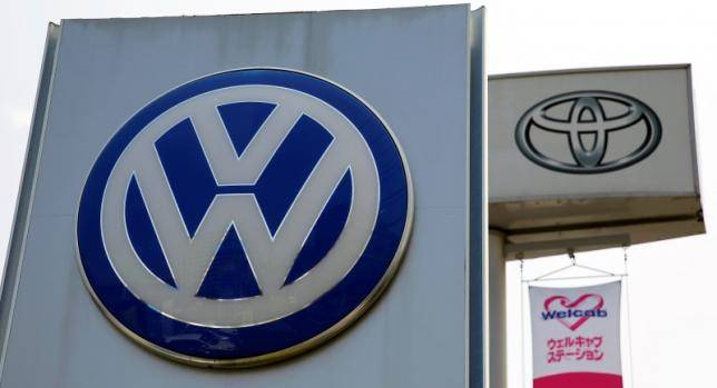 The logos of Volkswagen and Toyota Motor Corp are seen at their dealership in Tokyo, Japan