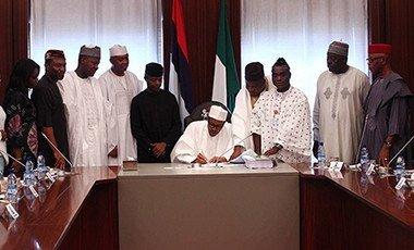 Nigerian President, Muhammodu Buhari signing the 2016 Budget
