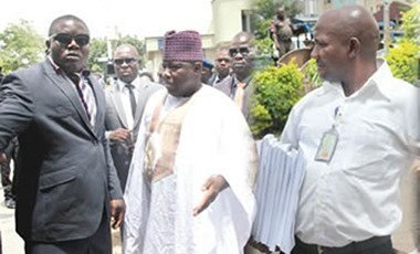 Former national chairman of the Peoples Democratic Party (PDP), Senator Ali Modu Sheriff, arriving at the party secretariat, after the consultation from Force headquarters and Bailiff Officer from Federal High Court, Mr Bentu Moses, with the document that affirms Senator Sheriff as authentic chairman of the party.