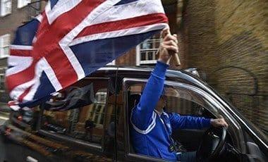 Taki Driver holding UN Flag