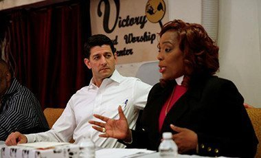 Speaker of the House Paul Ryan listens to House of Help City of Hope CEO Bishop Shirley Holloway as he holds an event to discuss the Republican Party's anti-poverty plan in the Anacostia neighborhood of Washington, U.S. June 7, 2016.