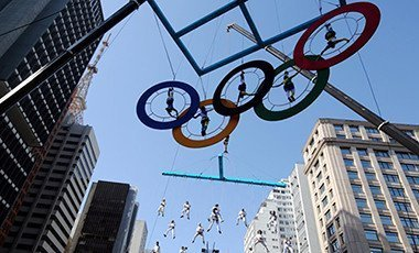 Acrobats performing on the Olympics rings