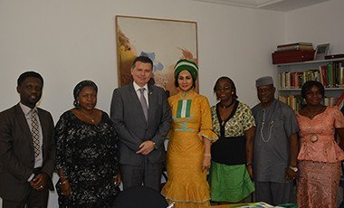Sally Mbanefo with Switzerland Ambasaddor Eric Mayorac