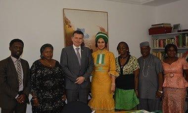 Sally Mbanefo with Switzerland Ambasaddor Eric Mayorac
