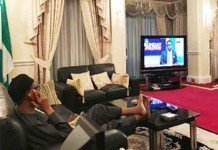 President Buhari watching news about Nigeria