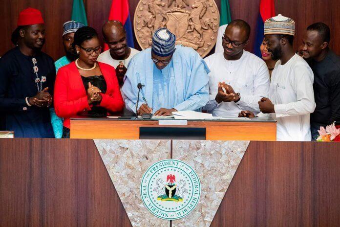 Buhari signing Not Too Young To Run Bill