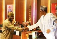 Muhammadu Buhari shaking Kayode Fayemi