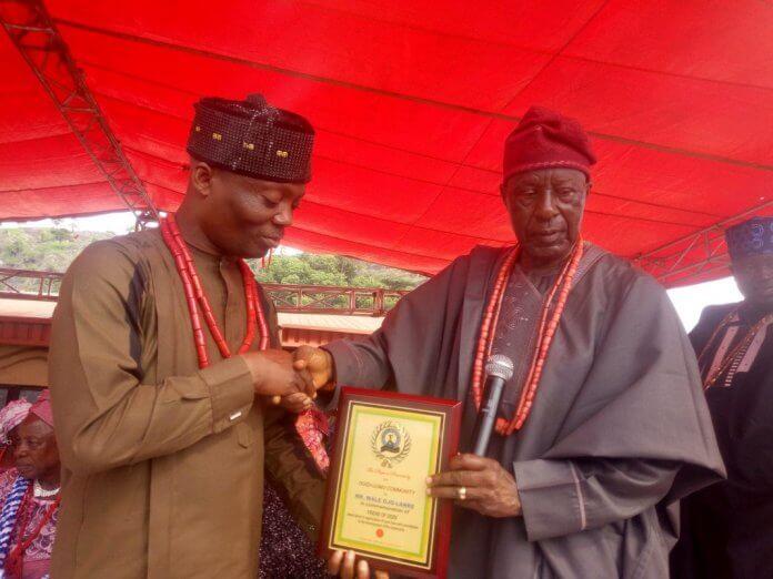 Wale Ojo-Lanre receiving an award from an Ogidi Community chief
