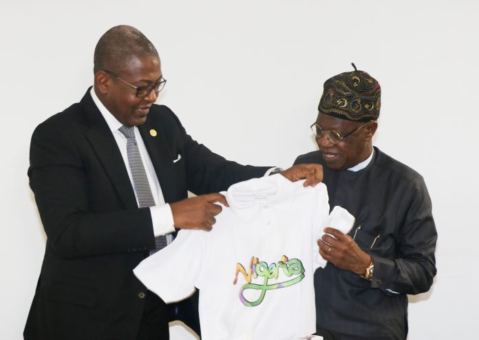 Folorunsho Coker presenting a Tour Nigeria T-Shirt to Alh. Lai Mohammed